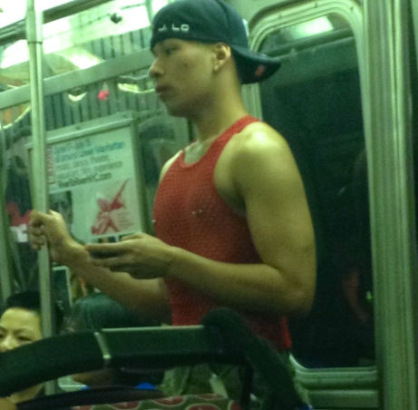 Subway guy wearing red, mesh top and nipple rings