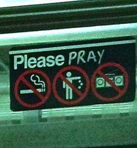 Subway sign says please pray no smoking no littering no music