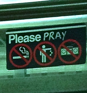 Subway sign says please pray no smoking no littering no music